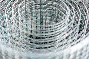 A roll of hardware  metal mesh cloth. Abstract blurred vision