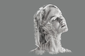 double exposure of attractive woman with closed eyes and plants isolated on grey
