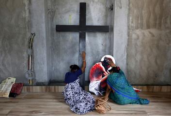 Women pray inside a church ahead of Good Friday celebrations in Kolkata