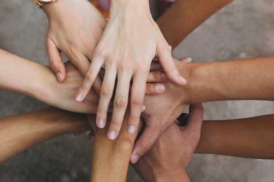 Close up top view hands teamwork in cooperation of business.