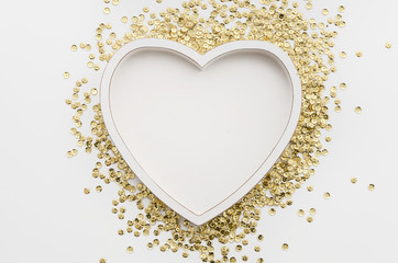 Heart shaped white photo frame with golden sparkles. Romantic concept mockup