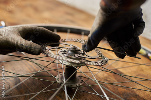 Cropped shot of mechanic making service in bicycle repair