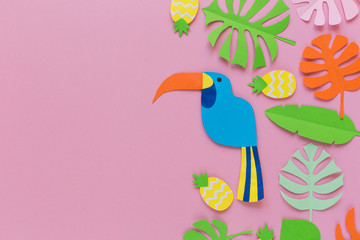 Pink background with pineapples, bird, and leaves