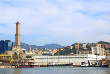 Genoa harbor with the container port and the lighthouse called La Lanterna  built around 1128, it is one of the world oldest and represents the symbol of the city.