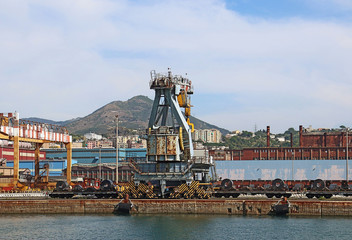 Sea view of the industrial harbor of Genoa, Italy  with cranes and the structures of the containerport