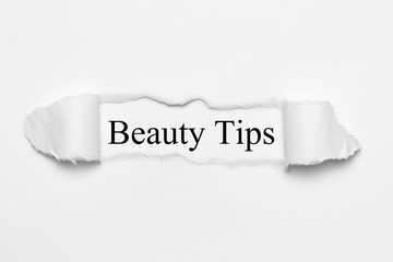 Beauty Tips on white torn paper