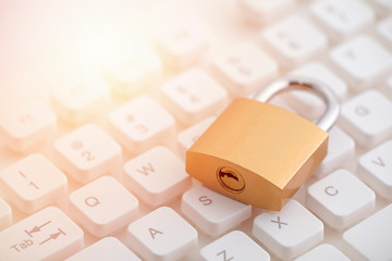 Security concept with metal padlock on computer keyboard