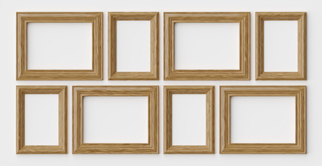 Wooden frames for picture or photo on white wall with shadows