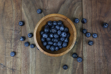 Bowl of Fresh Picked Blueberries on Rustic Wooden Table