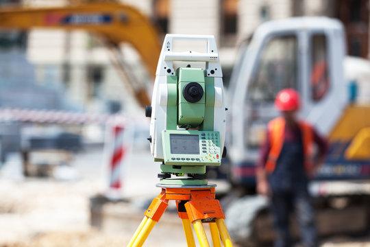 Theodolite or surveyor equipment tacheometer outdoors at construction site