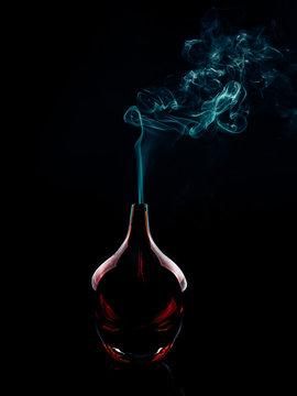 Glass bottle emitting smoke