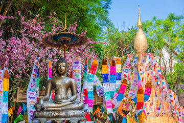 Prayer flags tung Hang with umbrella or Northern traditional flag hang on sand pagoda in the Phan Tao temple for Songkran Festival is celebrated in a traditional New Year's Day in Chiang Mai,Thailand Fototapete