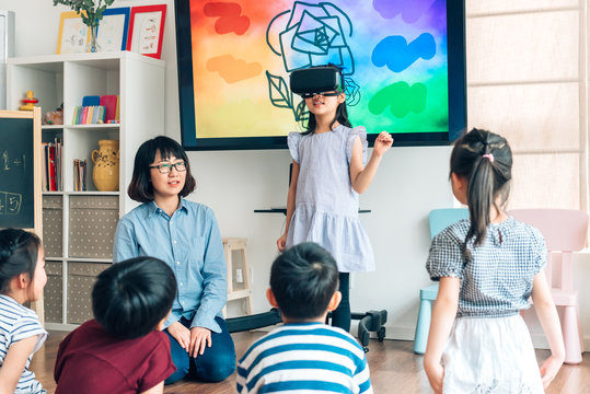 Preshool kids wearing virtual reality headset in classroom