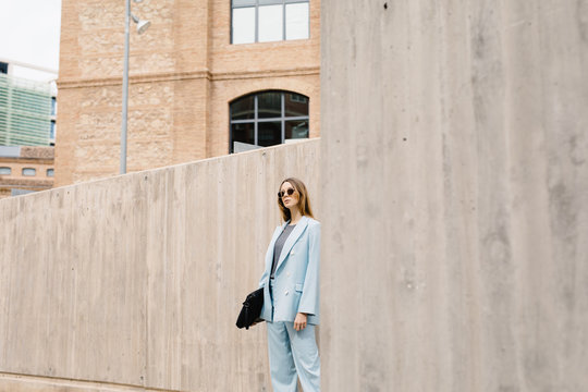 Trendy confident model in blue suit