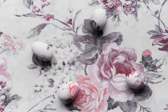 Close up of Easter eggs on floral table cloth