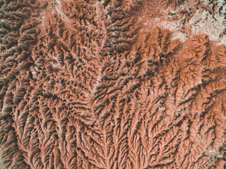 Aerial picture of a desert with eroded mountains