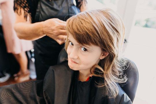 Flower Girl Getting Hair Styled for Wedding