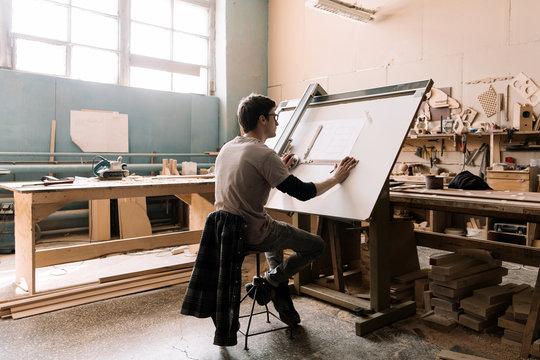 Professional craftsman making blueprint