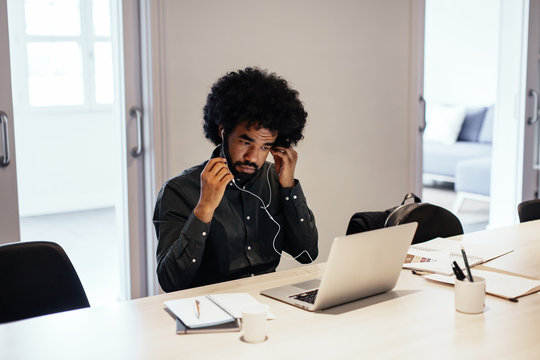 Afro businessman working at office.