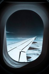 View out of airplane window at sky, shot in Infrared IR