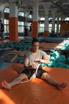 Man wearing elastic band in gym