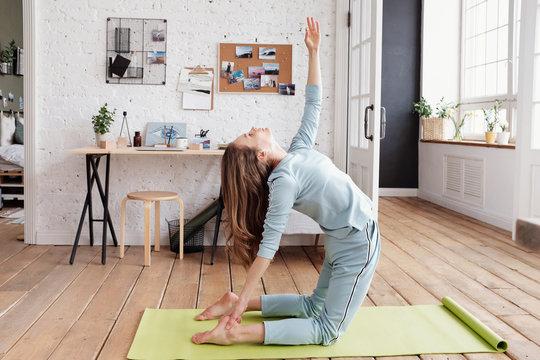 Woman doing Camel Yoga Pose