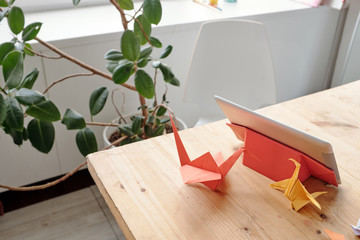Origami cranes on table