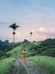 Woman walking in tropical scenery