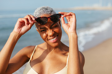 Portrait of woman with sunglasses on beach