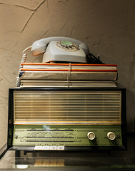 Antique radio, telephone and books