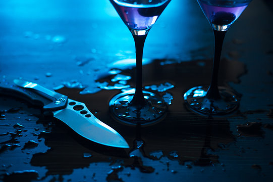 knife with martini splashes - conflict concept