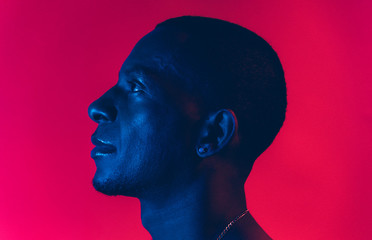 Portrait Of A Man Under Blue And Red Lights