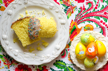 Easter cake with eggs and a bouquet of flowers