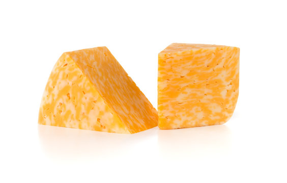 Marble cheese on a white background. Two triangles of cheese close up.