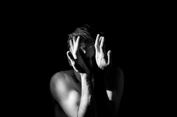 dramatic black and white photo, arms in an expressive bend near the head