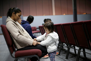 Honduran migrant Iris Ramos plays with her daughter Alejandra while watching a movie at Vino Nuevo church, which gives temporary shelter to migrants released by U.S. Customs and Border Protection (CBP) due overcrowded facilities, in El Paso