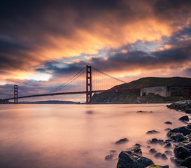 Golden Gate Bridge with sunset clouds