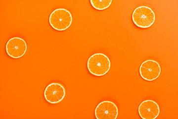 Wall Mural - Cut orange fruit, top view.