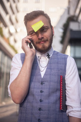 one young silly man, posing with post-it note attached glued to his forehead.