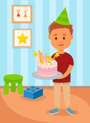 Boy in Birthday Hat Holding Cake in Kids Room.