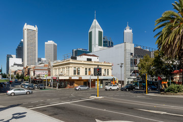 Beautiful view of Perth city center, Western Australia, with the moon in the blue sky