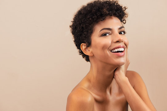 Happy african woman after beauty treatment