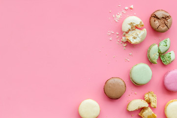 Fotobehang Macarons Macarons design on pink background top view space for text