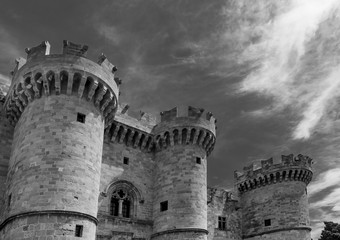 Black and white view of the Palace of the Grand Master of the Knights of Rhodes against a dramatic sky, Greece