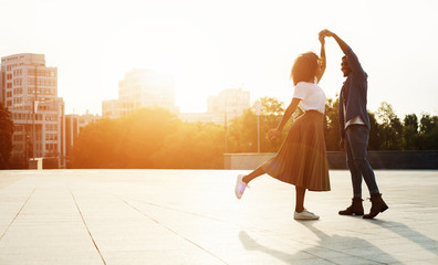 Love is in the air. Romantic couple dancing at sunset