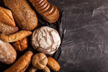 Assortment of baked goods on dark background