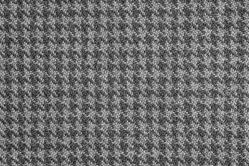 Classic houndstooth cloth pattern texture background.