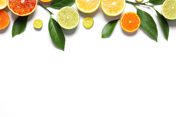 Fototapete - Flat lay composition with different citrus fruits on white background