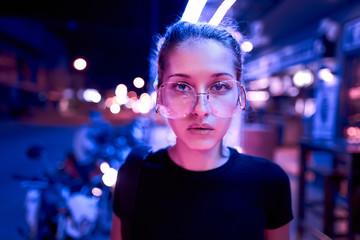 portrait of beautiful woman in neon light. night city street shot Fotomurales