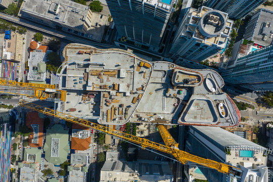 Aerial construction site overhead inspection cranes and concrete